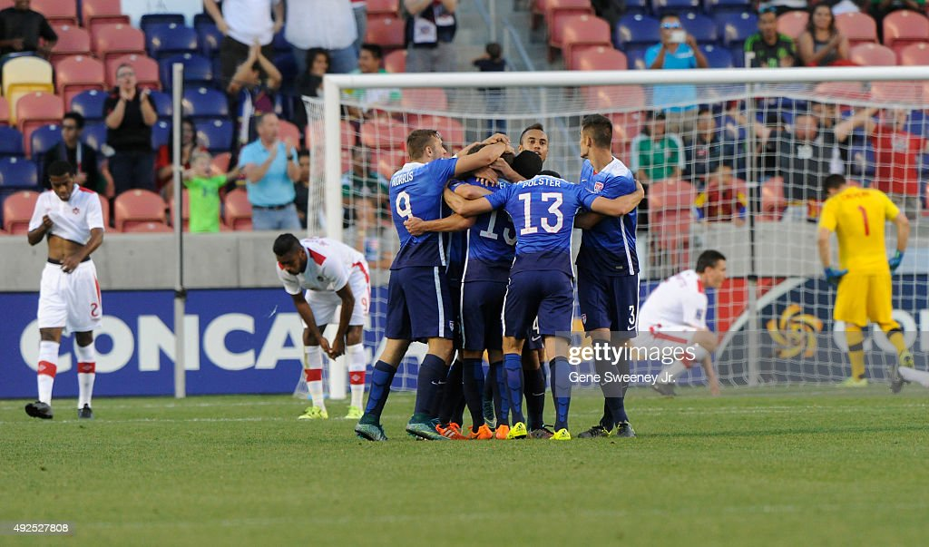 United States team members surround Marc Pelosi #15 of the United States after he scored the winning goal against Canada in the 2nd half of the third place CONCACAF Olympic Qualifying match at Rio Tinto Stadium on October 13, 2015 in Sandy, Utah. The United States beat Canada 2-0.