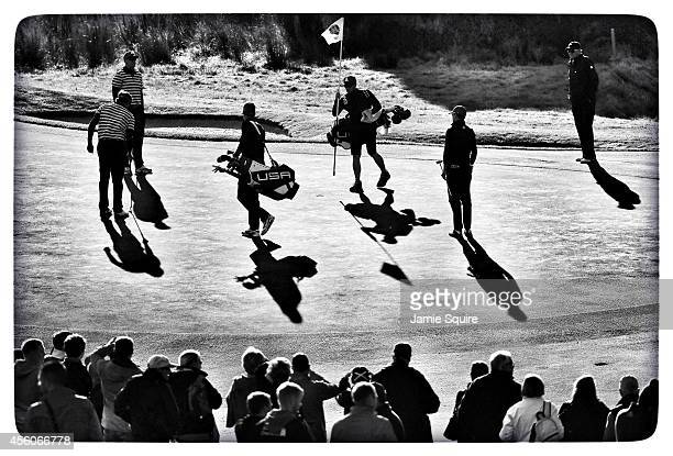 United States team members walk on the 9th green during practice ahead of the 2014 Ryder Cup on the PGA Centenary course at the Gleneagles Hotel on...