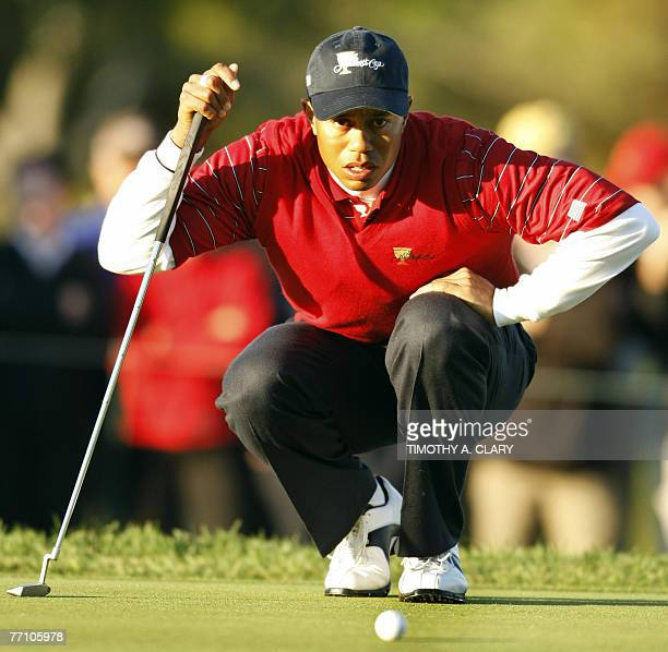 United States Team player Tiger Woods lines a putt on the 3rd hole during the Foursome Matches of The Presidents Cup 29 September 2007 at The Royal...