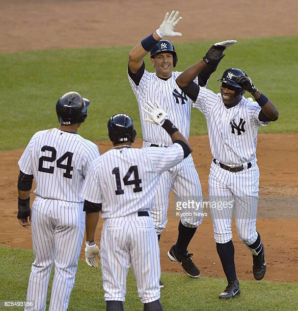 NEW YORK United States The New York Yankees' Alfonso Soriano celebrates with teammates Robinson Cano Curtis Granderson and Alex Rodriguez after...