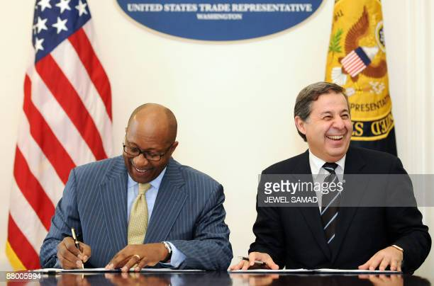 United States Trade Representative Ron Kirk and Egypt's Trade Minister Rachid Mohamed Rachid sign an agreement at the Office of the US Trade...