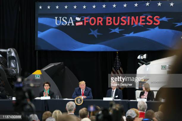 United States Treasurer Jovita Carranza US President Donald Trump and business owner Bob Nuss attend at a roundtable on the economy and tax reform at...