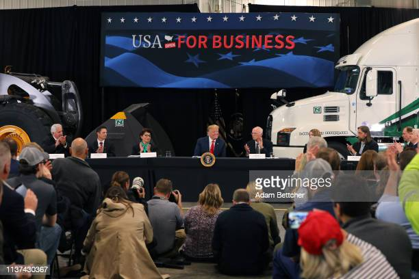 United States Treasurer Jovita Carranza US President Donald Trump and business owner Bob Nuss speak at a roundtable on the economy and tax reform at...