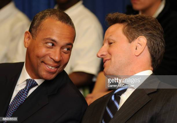 United States Treasury Secretary Timothy Geithner speaks with Massachusetts Governor Deval Patrick prior to announcing the national recipients of...