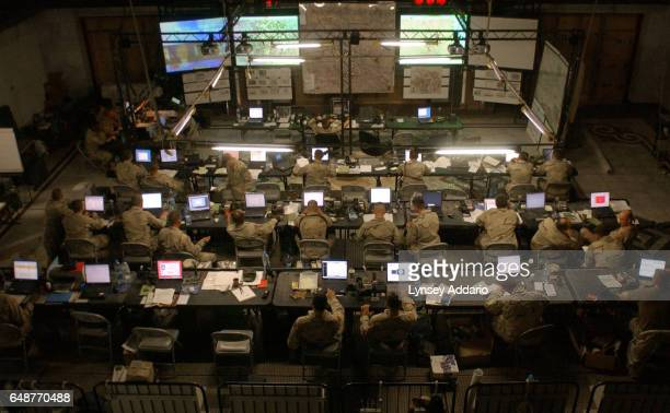 United States troops from the 101st Airbourne Division work out of the battle command center of the Division Main Headquarters in one of Saddam...
