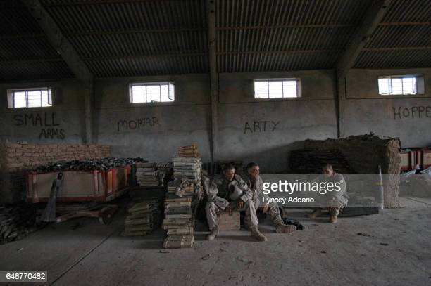 United States troops guard artillery and weapons collected after the fall of Iraqi leader Saddam Hussein in the Division Main Headquarters in one of...
