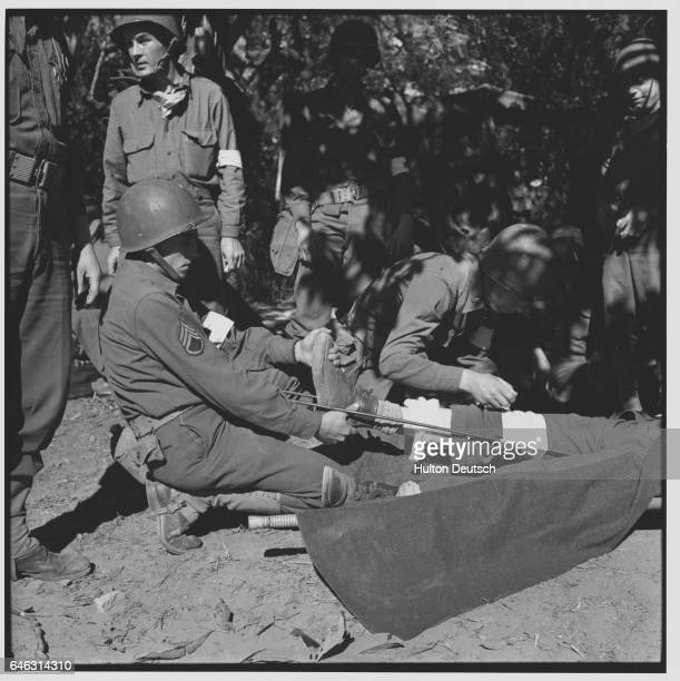 United States troops tend to their injured in North Africa during World War II