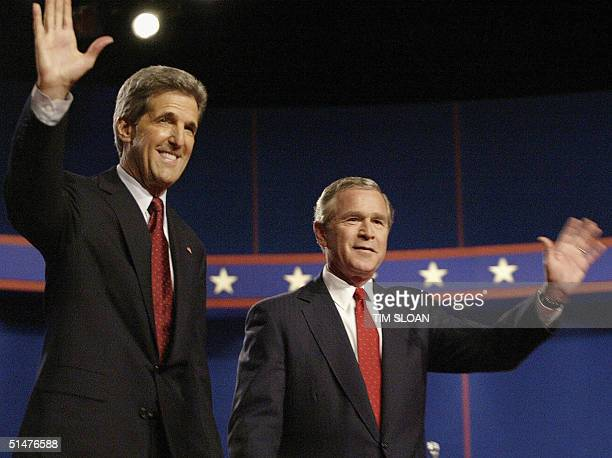 US President George W Bush and Democratic presidential candidate John Kerry wave to the audience before their face off in a final televised debate 13...