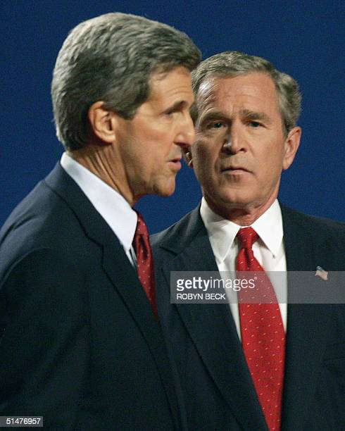 US President George W Bush and Democratic presidential candidate John Kerry are seen in a final televised debate 13 October 2004 at Gammage...