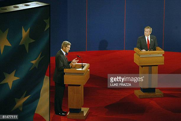US President George W Bush and Democratic presidential candidate John Kerry face off in a final televised debate 13 October 2004 at Gammage...