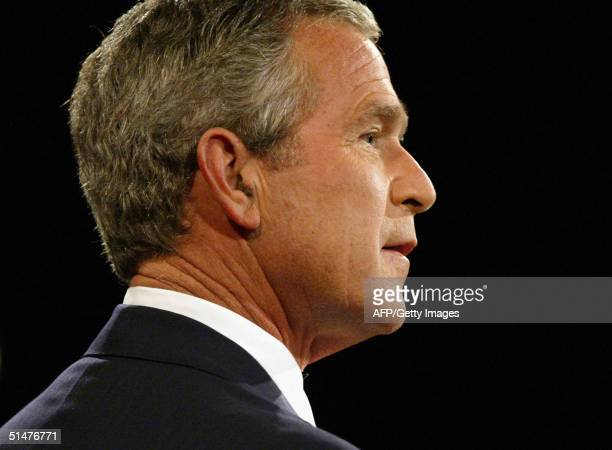 US President George W Bush answers a questions during the third televised debate with Democratic presidential candidate John Kerry 13 October 2004 at...