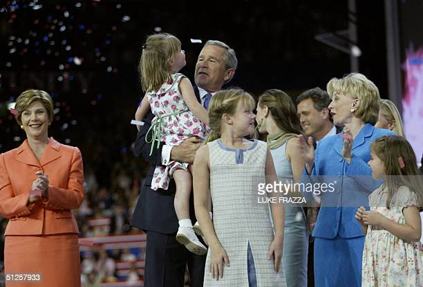 US President George W Bush holds Grace Perry granddaughter of Vice President Dick Cheney at the conclusion of the Republican National Convention at...