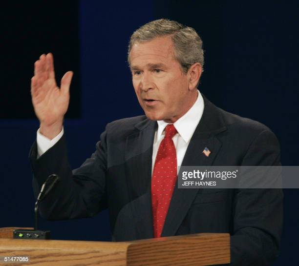US President George W Bush makes a point during a final televised debate with presidential candidate John Kerry 13 October 2004 at Gammage Auditorium...