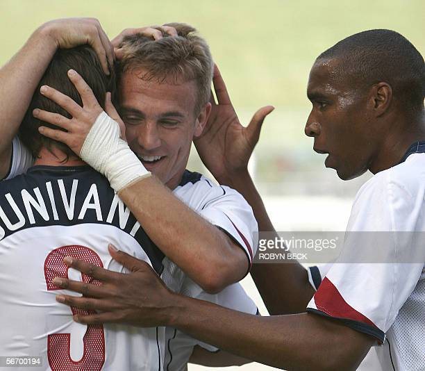 USA mens national soccer team forward Taylor Twellman celebrates with teammates Eddie Pope and Kerry Zavagnin after scoring his second goal against...