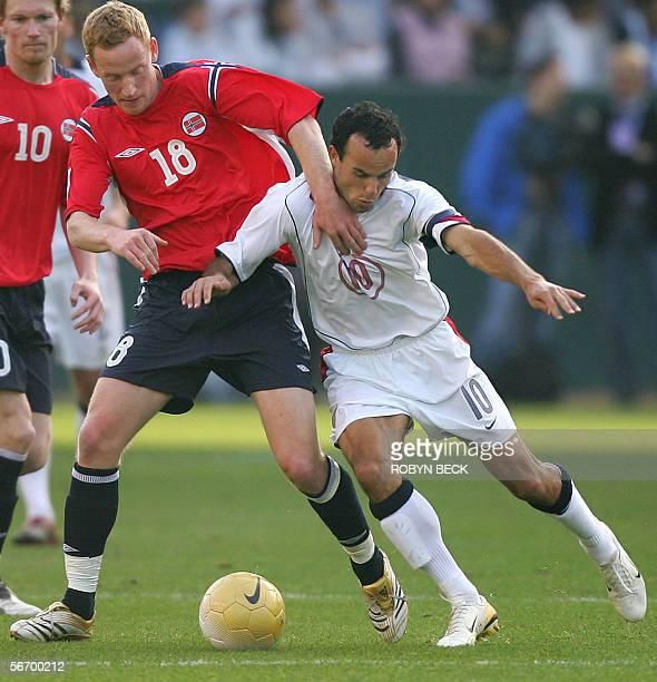 United States: USA men's national soccer team midfielder Landon Donovan challenges Norway's forward Epsen Olsen during second half action in a...