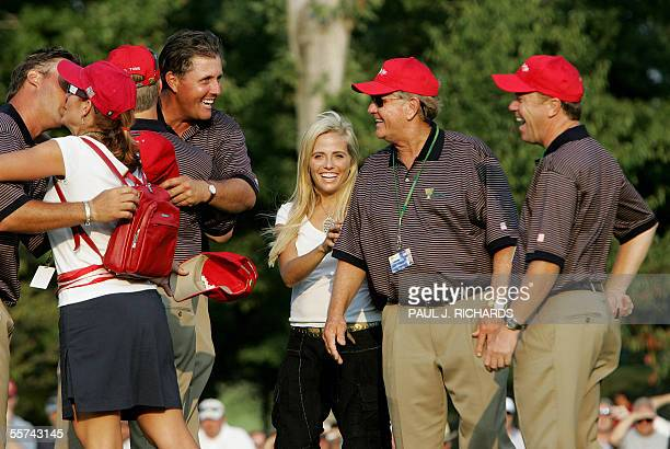 USA team captain Jack Nicklaus and assistant captain Jeff Slumanlook on as Phil Mickelson is embraced by David Toms as Mickelson's wife Amy stands by...