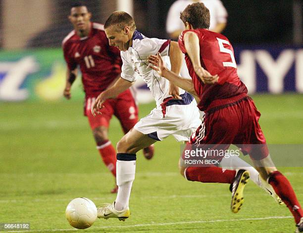 USA's substitute forward Chris Rolfe moves the ball past Canada's Marco Reda and Patrice Bernier during a friendly 22 January 2006 in San Diego CA...