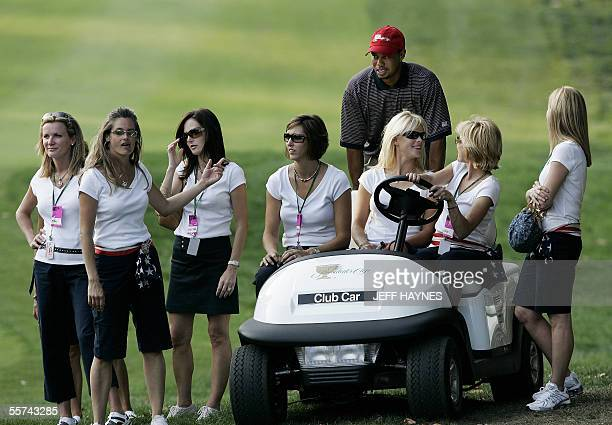 United States: USA's Tiger Woods waits with the wives of USA players after foursome matches at the 2005 Presidents Cup 22 September, 2005 at the...