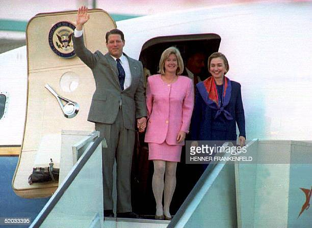 United States Vice President Al Gore his wife Tipper and US First Lady Hillary Clinton wave as they arrive at Jan Smuts airport near Johannesburg 09...