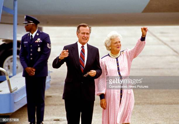 United States Vice President George HW Bush and Barbara Bush wave on the tarmac New Orleans Louisiana August 16 1988 They had just arrived for the...