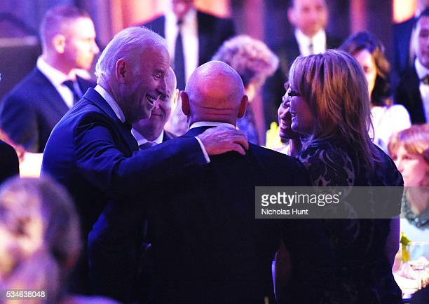 United States Vice President Joe Biden speaks with astronaut Scott Kelly astronaut Mark Kelly Amiko Kauderer and Gabby Giffords at the speaks at the...