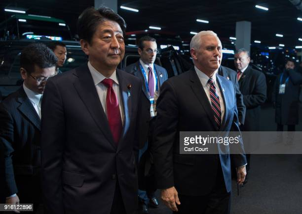 United States Vice President Mike Pence and Japan's Prime Minister Shinzo Abe arrive to attend a ceremony reception ahead of the PyeongChang Winter...