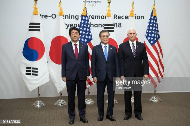 United States Vice President Mike Pence Japan's Prime Minister Shinzo Abe and South Korea's President Moon Jaein pose for photographs during a...