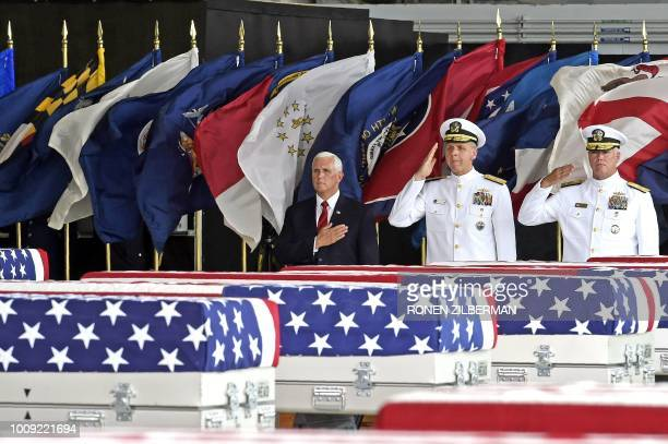 United States Vice President Mike Pence pay respects as Commander of US IndoPacific Command Admiral Phil Davidson and deputy director of the DPAA...
