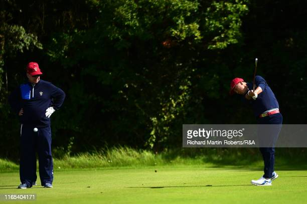 United States Walker Cup Team Captain Nathaniel Crosby watches John Pak tee off during a practice round at Royal Birkdale Golf Club prior to the 2019...