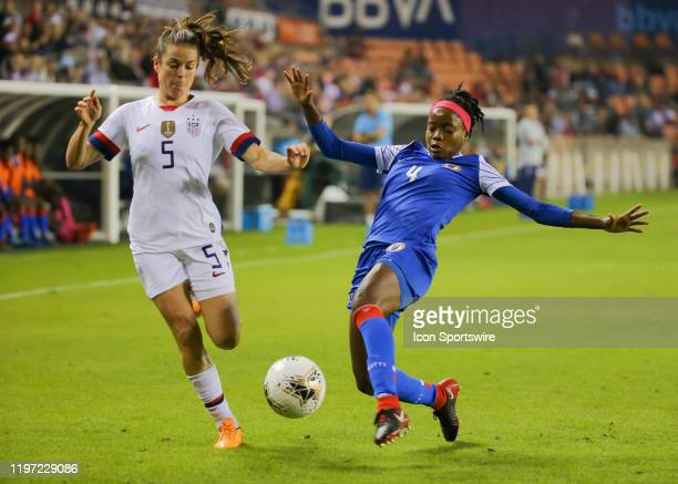 United States Women's Olympic Soccer defender Kelley O'Hara and Haiti Women's Olympic Soccer defender Ruthny Mathurin fight for ball during the...