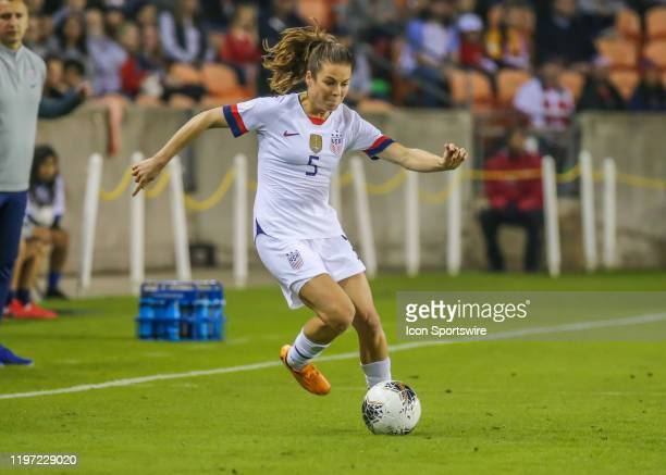 United States Women's Olympic Soccer defender Kelley O'Hara dribbles the ball during the CONCACAF Women's Olympic Qualifying soccer match between USA...