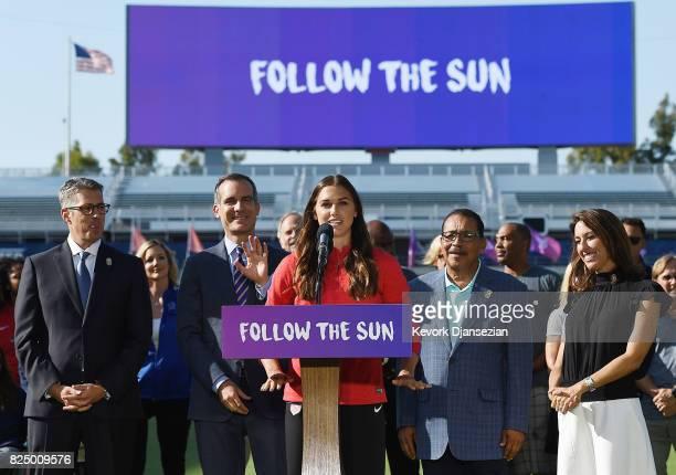 United States Women's soccer team forward Alex Morgan speaks at the podium with LA 2024 Bid Chairman Casey Wasserman Los Angeles Mayor Eric Garcetti...