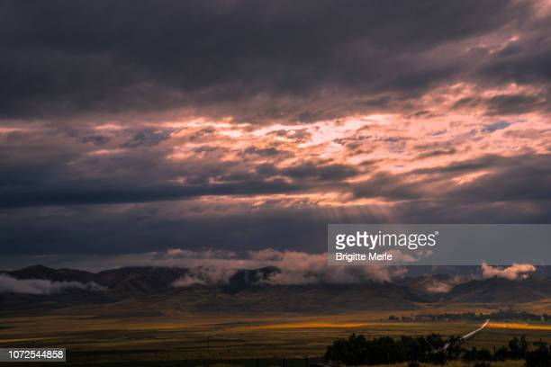 united states, wyoming, on the road, north salt lake city, beams of light at sunset - road salt stock pictures, royalty-free photos & images