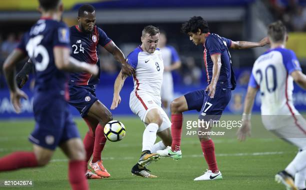 United States's forward Jordan Morris battles Costa Rica's Costa Rica's forward Jose Leiton and midfielder Yeltsin Tejeda during their the CONCACAF...