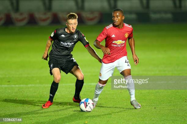 United Teden Mengi keeps possession during the EFL Trophy match between Salford City and Manchester United at Moor Lane Salford England on September...