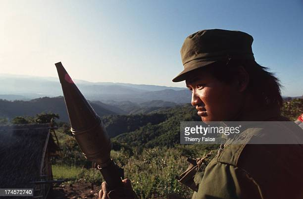 United Wa State Army soldier on the road with a grenade launcher in southern Wa State near the Thai border