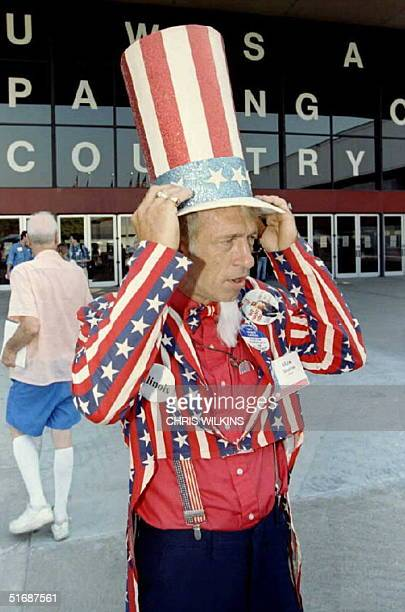 United We Stand America member Max Shaffer of Madison County Illinois adjusts his Uncle Sam hat as he stands outside the Dallas Convention Center...