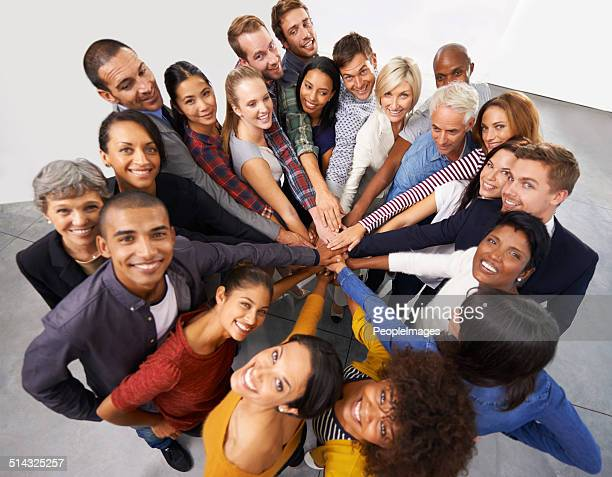 united we stand - hands clasped stock pictures, royalty-free photos & images