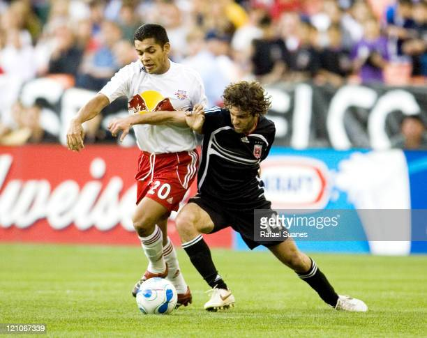 DC United's Ben Olsen gets an arm in front of New York Red Bull's Amado Guevara at RFK Stadium in Washington DC on Sunday April 2 2006 The Red Bulls...