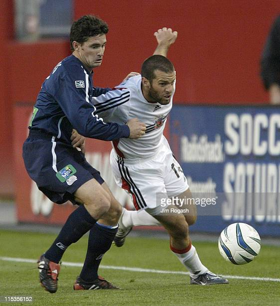 United's Ben Olsen, right, battles New England Revolution's Jay Heaps for control of the ball at Gillette Stadium, Saturday, May 29 in Foxboro,...
