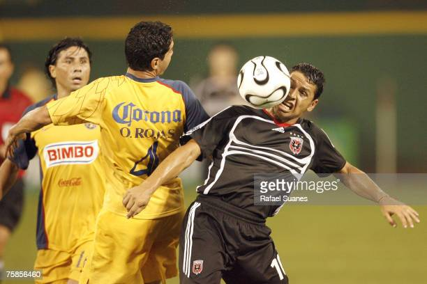 United's Christian Gomez get hit in the face by the ball while fighting for control with Club America's Oscar Rojas at RFK Stadium in Washington, DC...