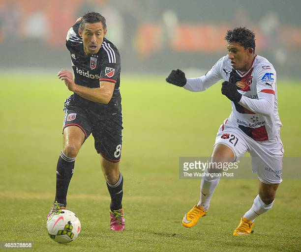 United's Davy Arnaud left drives the ball against Alajuel's Jose Oritiz during DC United's defeat of Alajuela of Costa Rica 2 1 in the quarterfinals...
