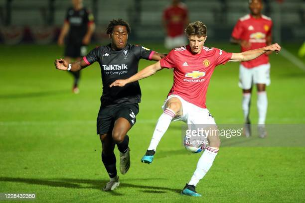 Uniteds Ethan Laird battles with Salfords Brandon Asante during the EFL Trophy match between Salford City and Manchester United at Moor Lane Salford...
