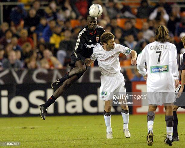United's Ezra Hendrickson outjumps New England's Pat Noonan for the ball during the MLS Eastern championship game at RFK Stadium in Washington DC,...