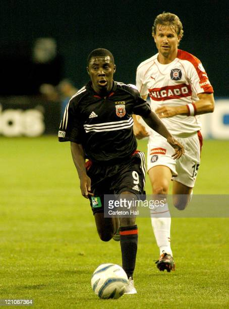 United's Freddy Adu, left, dribbles past Chicago's Jesse Marsch. The Chicago Fire tied D.C. United with a score of 1-1 on Saturday April 9, 2005 at...
