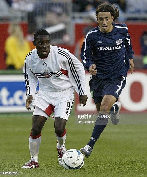 United's Freddy Adu, left, moves the ball by New England Revolution's Jose Cancela at Gillette Stadium, Saturday, May 29 in Foxboro, Massachusetts....