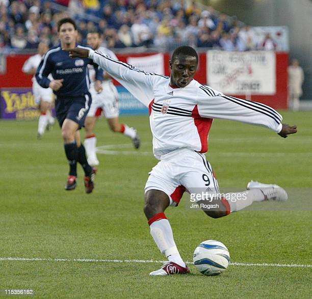 United's Freddy Adu shoots on the goal of the New England Revolution at Gillette Stadium, Saturday, May 29 in Foxboro, Massachusetts. D.C. United won...