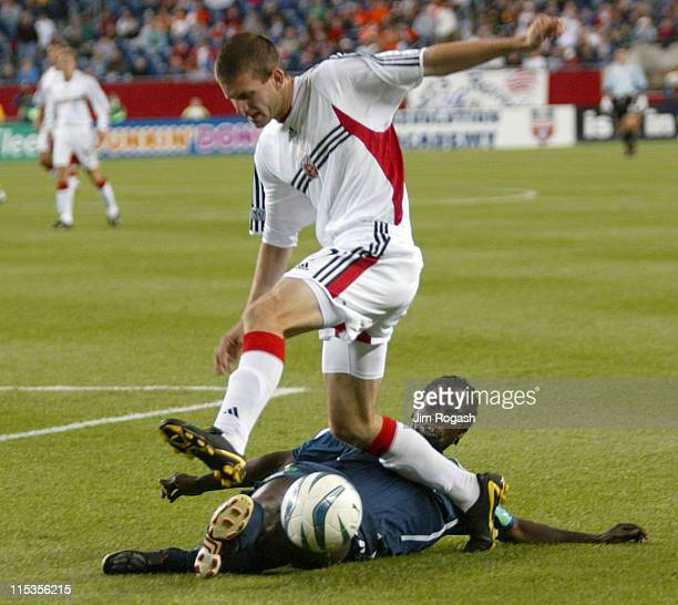 D C United's Goshua Gros top leaps over Felix Brillant of the New England Revolution at Gillette Stadium Saturday May 29 in Foxboro Massachusetts DC...