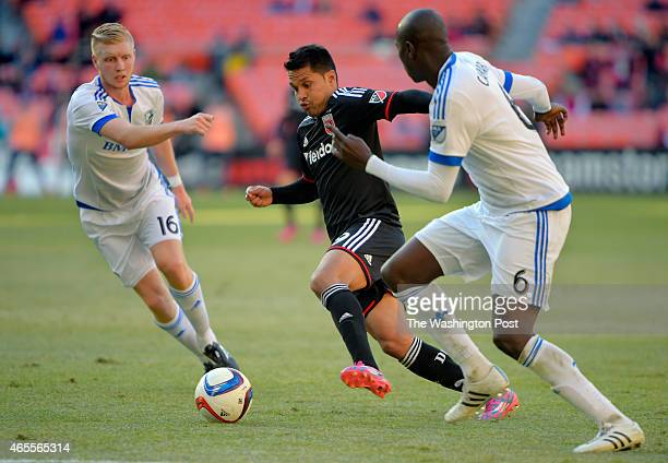 United's Jairo Arrieta center splits the defense of Montreal's Calum Mallace left and Hassoun Camara during the DC United's defeat of the Montreal...