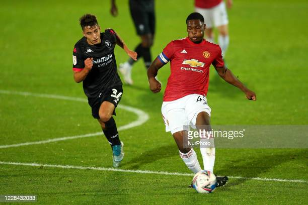 Uniteds Teden Mengi has a shot on goal during the EFL Trophy match between Salford City and Manchester United at Moor Lane Salford England on...
